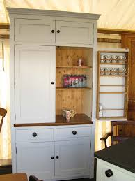 this larder here on the left has been built from scratch and is ready to put into your kitchen it is quite similar to the one you see in
