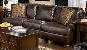 reverse auction ashley furniture axiom walnut leather sofa loveseat chair 1 2 and ottoman