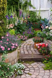 garden pathway. Tiered Garden Path With Raised Bed Borders Of Fragrant Dianthus, Digitalis Foxglove Vertical Tall Plants Pathway