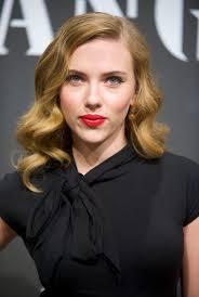 Scarlett Johansson black blouse green eyes light brown old.