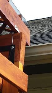 the water drains off of the diy covered patio on to the roof and into the
