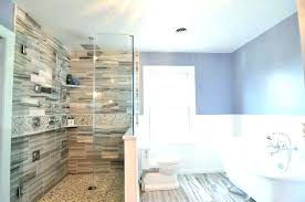 glass shower surround tub glass shower enclosure master bath natural stone tile mosaic wainscoting surround wall