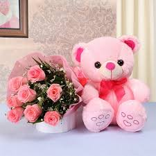 cute pink teddy bear with flowers