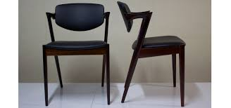 a pair of kai kristiensen danish dining room chairs in leather