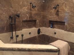 dual recessed niche in emperador marble tile shower