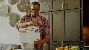 a man at home seals a priority mail envelope