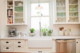 lighting kitchen sink kitchen traditional. Sink Lighting Kitchen. Appealing White Kitchen Subway Backsplash As Well Porcelain Farmhouse And Sweet Traditional