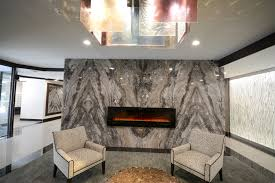 electric fireplace set in the granite wall