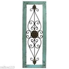 turquoise wood and metal wall art
