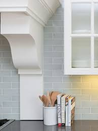 subway tiles in a pale blue gray give depth to the backsplash and make the