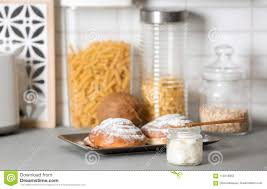 Jar With Coconut Oil And Tasty Pastry On Table In Kitchen Stock