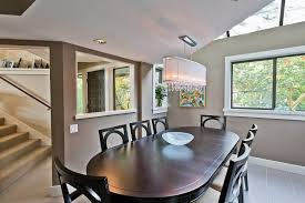 vancouver barbara barry dining room contemporary with tile floor oval standard height tables crystal chandelier