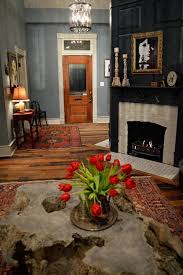 black and gray den with brick fireplace