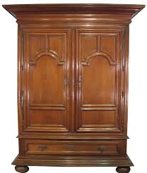 large dutch walnut armoire with bun feet and lower drawer holland ca 1860