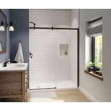 frameless sliding shower door in dark bronze