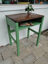 old wooden school desk in green ith darker stained top modern vintage
