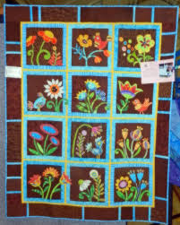 """I loved this piece, """"Vertigo"""", made and quilted by Audrey Keebler. """"My Whimsical Garden"""" made by Robbie Rodgers quilted by Susan Krinks. - dscn1823_edited-2"""