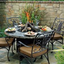 garden and patio outdoor dining area with round marble top dining table with wood burning