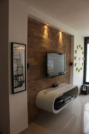 Small Picture Love the texture of the wall with the modern floating cabinet and