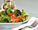 a salad of arugula  rocket   cherry tomatoes and sesame seed