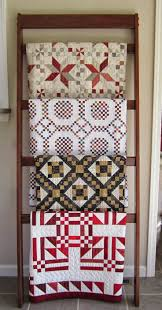 Sew Kind Of Wonderful: Tuesday Tips - Displaying Quilts & http://alittlebitbiased.blogspot.com/2012/11/blog-post.html Adamdwight.com