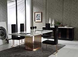 make it a royal affair with your dining table and opt for an oriental black marble top on golden carved wooden base this striking dining table will leave
