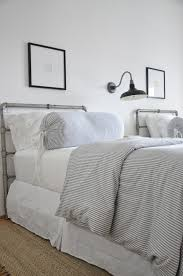 coastal-inspired bedroom, twin beds, ticking stripe bedding
