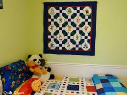 Quilt Kisses: Different Ways to Hang Quilts & In some of the bedrooms we have quilts hanging up with just a plain dowel. Adamdwight.com