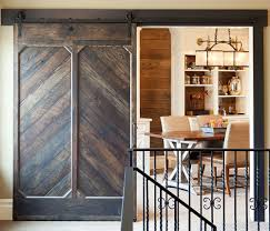 view in gallery custom designed barn door for the traditional home worke and library design john kraemer