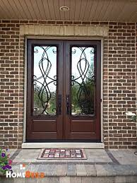 pella front doorsPella French entry door with custom wrought iron trim on the