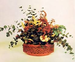 Buyers readily pay $15.00 for dried flower arrangements such as this one  made of glycerine-treated eucalyptus, hydrangea, goldenrod (dyed red), ...