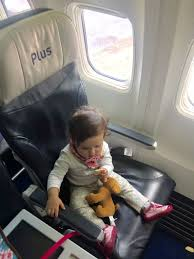 car seat on airplane baby on plane snacks toy puppy car seat on airplane rear facing