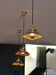 bowls bought from the laneway markets of kathmandu have been transformed into colourful pendant lights above the