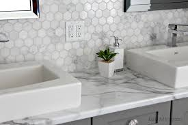 formica 180fx calacatta marble laminate countertop with hexagon marble accent tile and benjamin moore chelsea gray painted cabinet by kylie m interiors