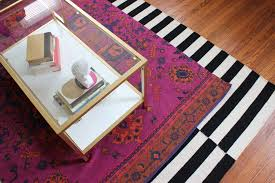 layered rugs from ikea and urban outfitters