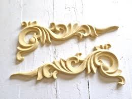 wood furniture appliques. all of our furniture appliques are reproductions antique carved originals made resin and wood fillers