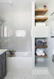 tiled bathrooms and showers. bathroom, white subway tile, mosaic floor glass shower tub, wood shelving carriage lane design-build inc. tiled bathrooms and showers