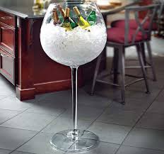 the giant wine glass cooler is an ice bucket shaped like a giant wine glass that measures 3 and a half feet tall and is probably the worst idea to have a