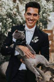 Couple's cat steals the show as groomsman in his very own tuxedo at wedding  | GMA