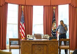 obama oval office desk. he had got rid of barack obamau0027s crimson curtains and replaced them with gold ones obama oval office desk b