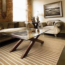 featuring an innovative blend of natural fibers including jute cotton straw and grass these durable flatwoven area rugs are hand loomed