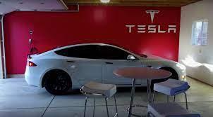 Model S Owner Transforms Home Garage Into A Tesla Gallery Showroom Garage Design Garage Makeover Garage House