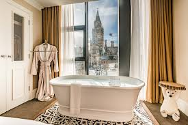 a luxurious free standing bath tub in a hotel room in the cotswolds