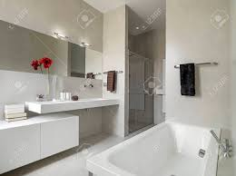 Panoramic View Of A Modern Bathroom With Washbasin And Bathtub ...