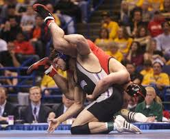 at the 2009 ncaa wrestling chionships at scottrade center northwestern s jake herbert bottom tangles with ohio state s mike pucillo in a 184 pound