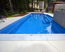 natural stone coping on a fiberglass pool with concrete patio pool intended for concrete pool