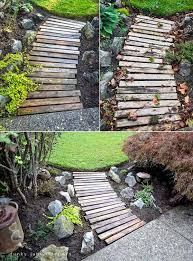 1 use salvaged wood from broken pallets to create garden paths