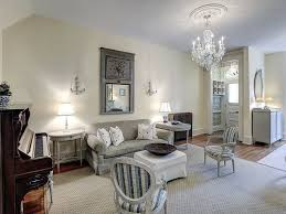 This Living Room Has Several Vintage Piece Of Furniture, As Well As An  Antique Mirror