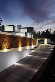 concrete fence design with good outdoor lighting for modern exterior home