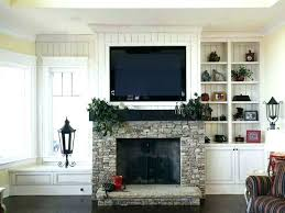 mount tv to brick fireplace mount brick fireplace hide wires mounting plasma pitched ceiling built ins